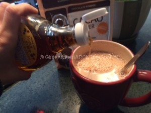 Mixing up gluten-free hot cocoa, adding in the maple syrup