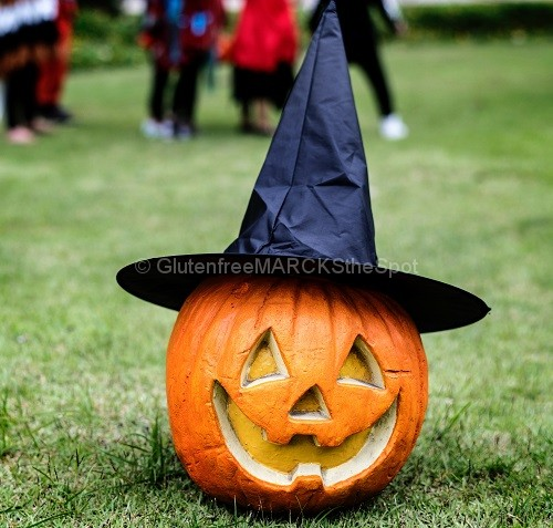 Carved pumpkin wearing a witch hat