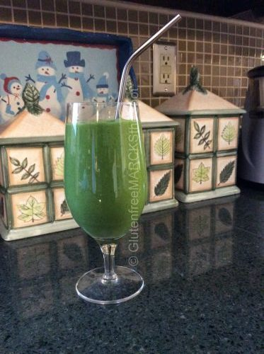 Green Smoothie on a glass with Metal Straw